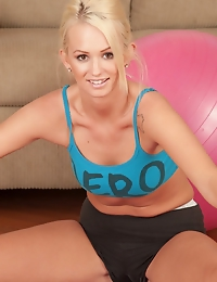 Gorgeous blonde coed Emily Austin stretches naked.