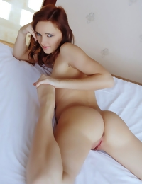 Cathleen A sultry appeal and inviting looks as she poses naked on bed